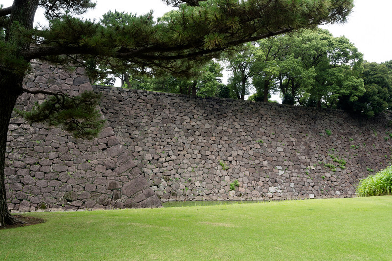 Since there is no mortar holding the stones together, the curved walls keep them from toppling in an earthquake.