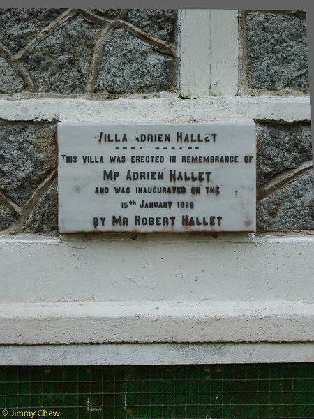 """Villa Adrien Hallet"" cast-in-stone affixed at the bungalow."