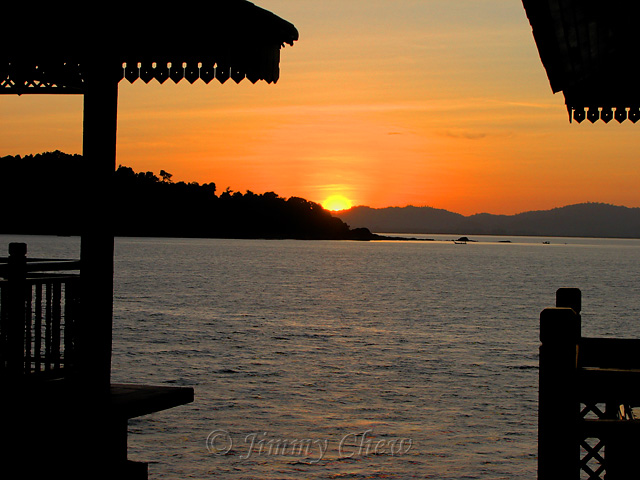 """<font color=""""yellow"""">Many said sunrise at this resort is not possible. But here it is, rising from the intersection of two hills.</font><br>"""