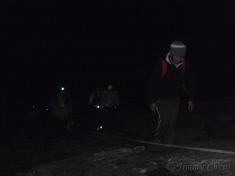 Headlamps and torchlights are used in the pitch black climb.