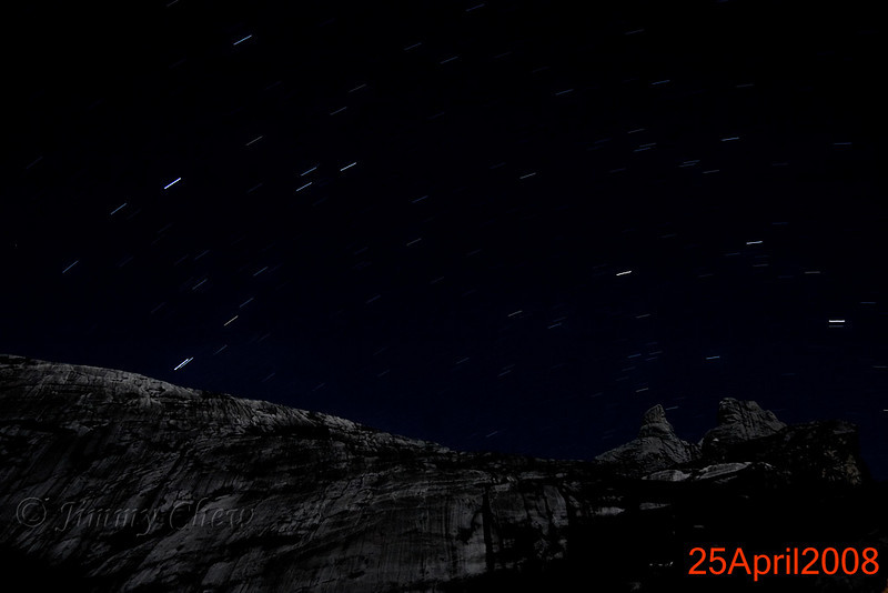Star streaks above Donkey's Ears' Peak. Moonlight provided some reflection off the huge granite rock. Photo shot from Laban Rata.