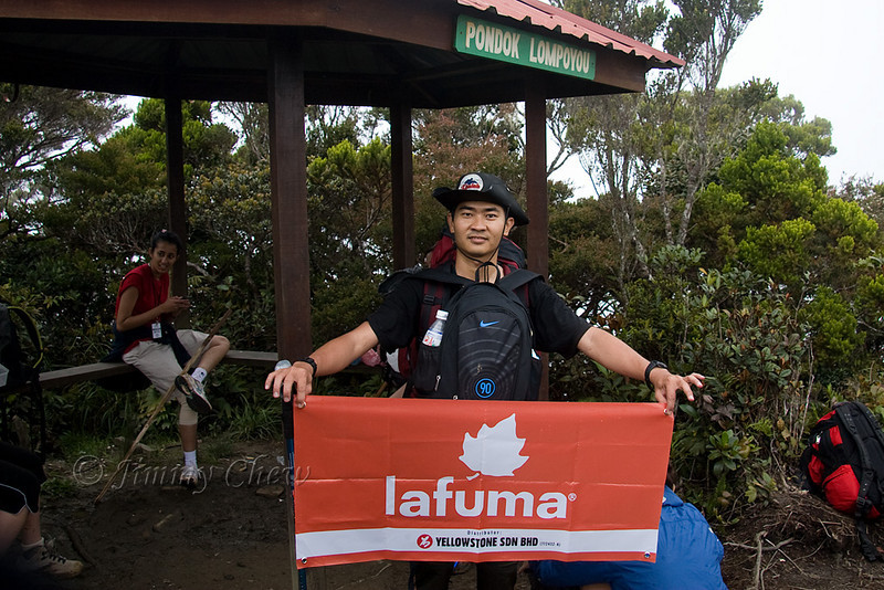 KT holding the banner at Pondok Lompoyou. We, along with another group of climbers, had lunch here.
