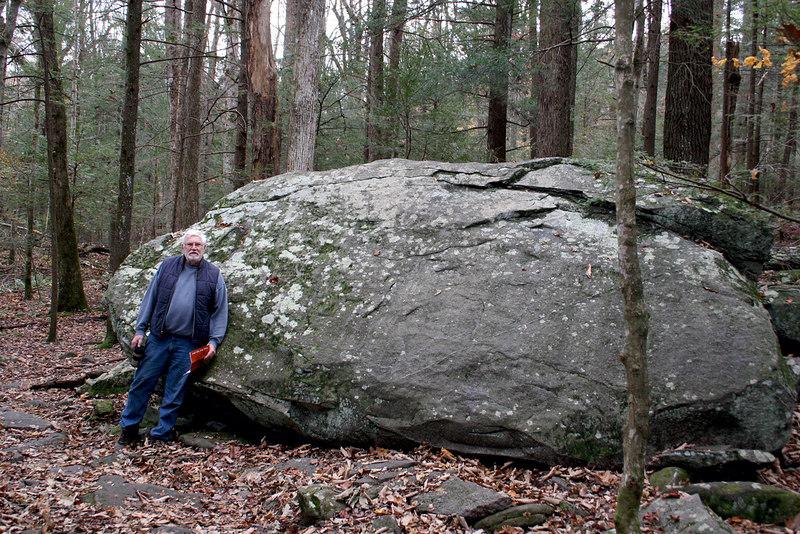 Mike beside huge rock along nature trail at Ogle farm