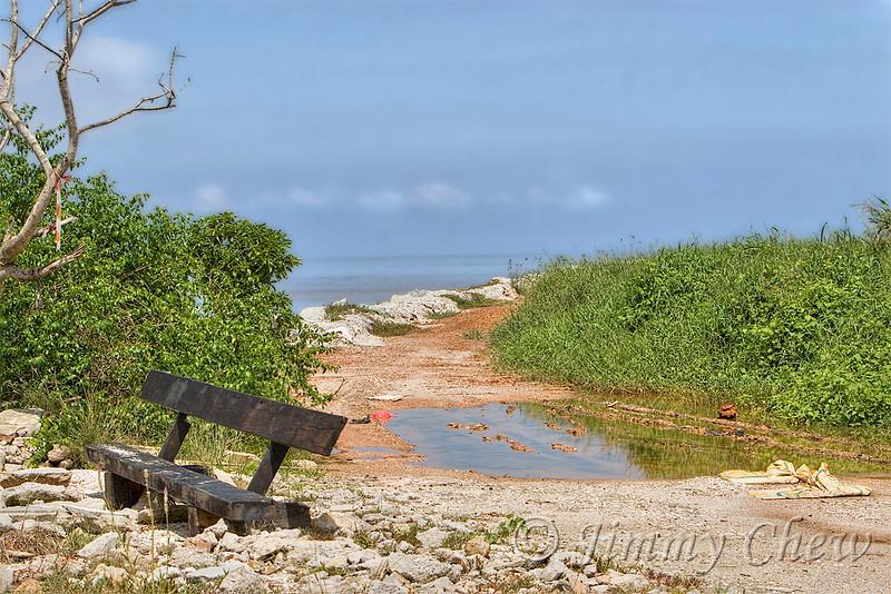 Bench alongside the Sekinchan beach.