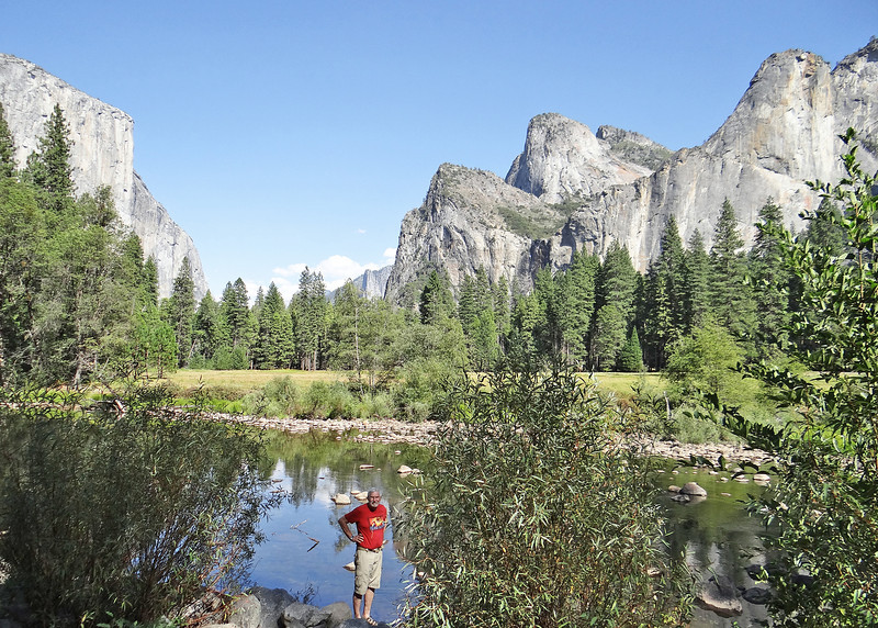 Mike along the Merced River with the Lower, Middle and Higher Cathedral Rocks in the background