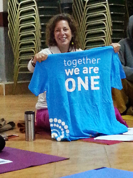 Jodi shows us our team shirts<br /> ~together we are one~