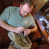 Fixin' my bestest pants shorts we can go camping.  Lisa had never seen a man sew before.  Odd!