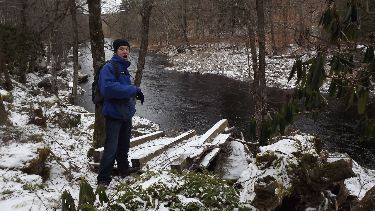 Young Mr. Barton points to a small footbridge that Hurricane Irene deposited 14 feet above the river.