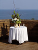 """I call this the Wedding Table, which holds a flower centerpiece, the rings, and the symbolic """"joining of two lives into one"""" sand."""