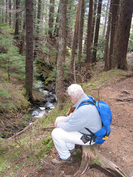 Mike enjoying a peaceful rest watching the creek