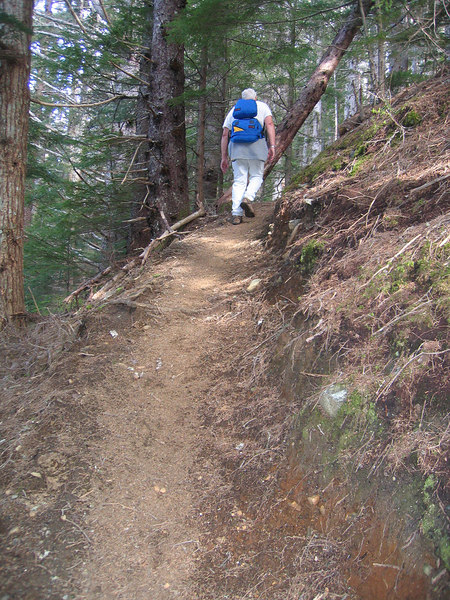 Following Mike up a steep incline