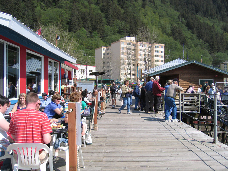Wharf where people are enjoying lunch out on this beautiful day