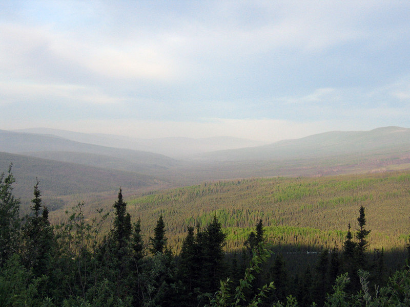 Countryside along the Elliott Highway on the way to the Dalton Highway.  You can see the Pipeline peeking out from the trees.  All the haze is from the Nenana fire.