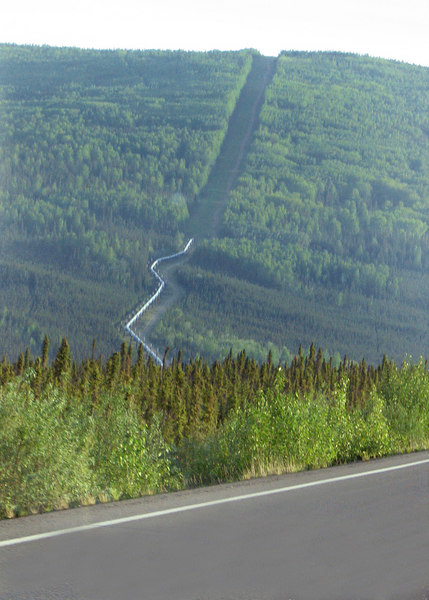 The Pipeline as it enters into the mountain along the Elliott Highway on the way to the Dalton Highway.