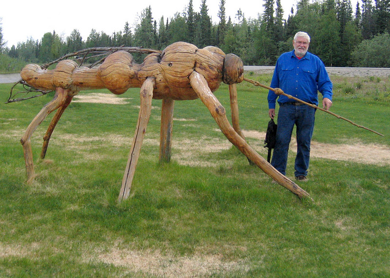 """Mike with the """"Alasquito"""" a huge burl Alaskan mosquito"""
