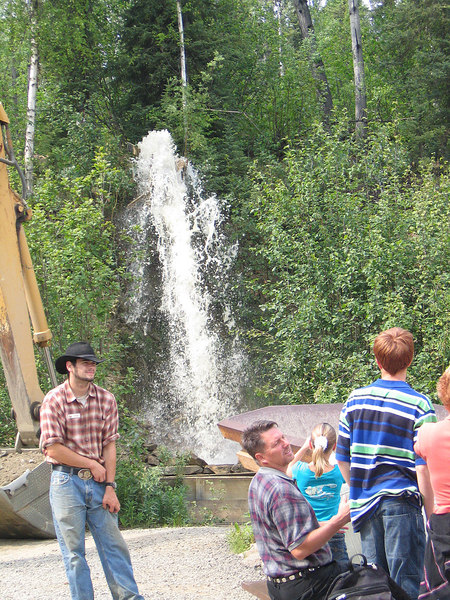 Water us used to wash the paydirt down the sluice.  They had just turned the water on and it was cascading down the hill.