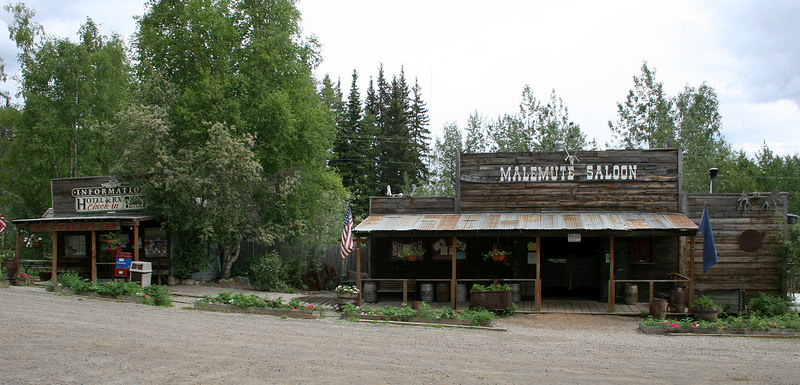 The old assay building on the left and the Malemute Saloon on the right in Ester, AK