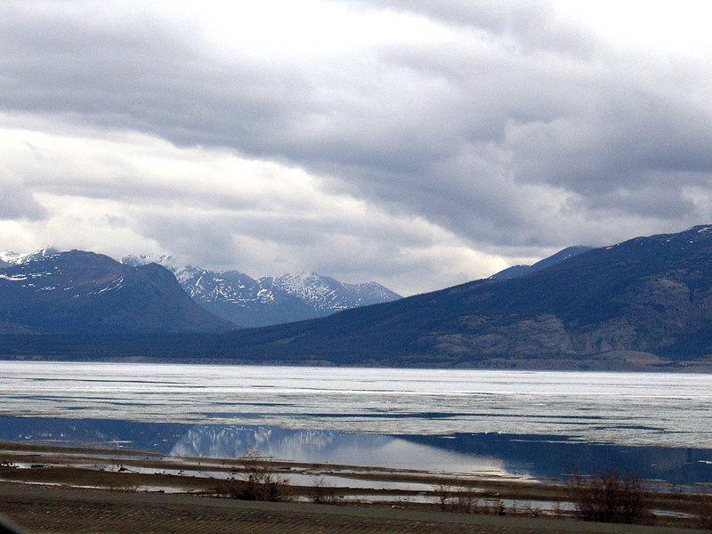 Ice on Kluane Lake with reflections in the water