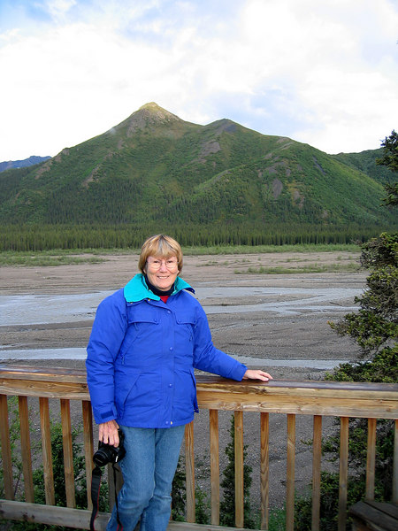 Susan with Teklanika River in background