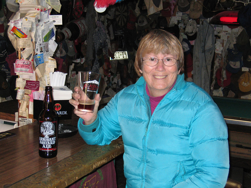 Susan with a glass of Arrogant Bastard Ale at the Chicken Creek Saloon