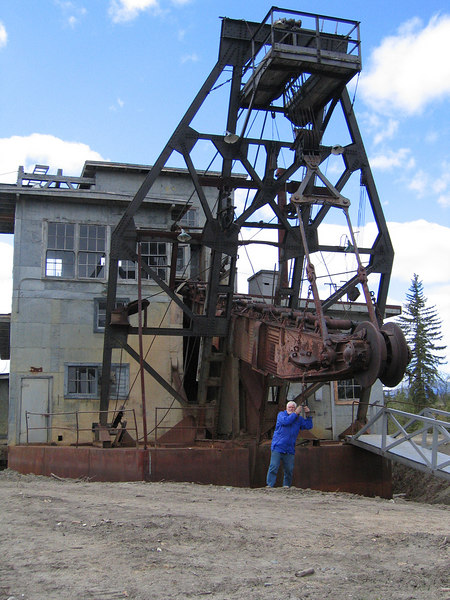 Mike is standing in front of the Pedro Dredge in Chicken, AK, see how big it is!