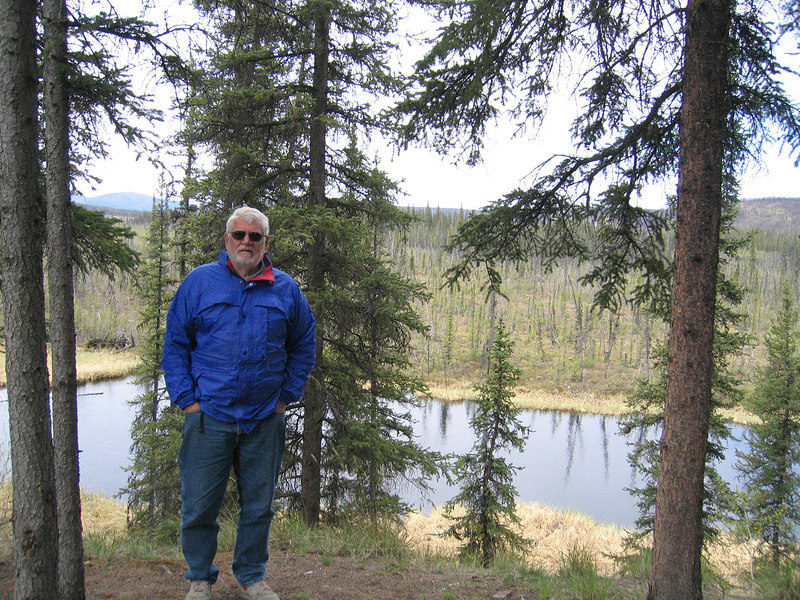 Mike with Johna's Lake in background at West Fork Campground about 15 miles from Chicken, AK