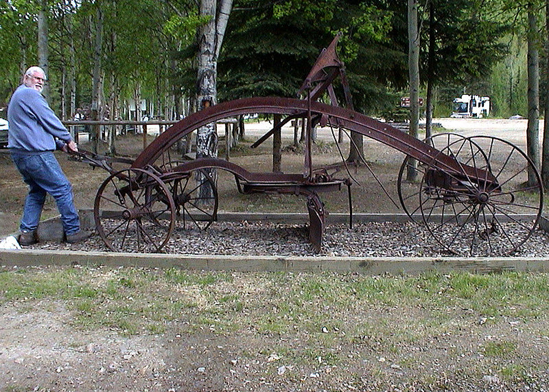 """Mike """"pulling"""" old plow at Chena Hot Springs"""
