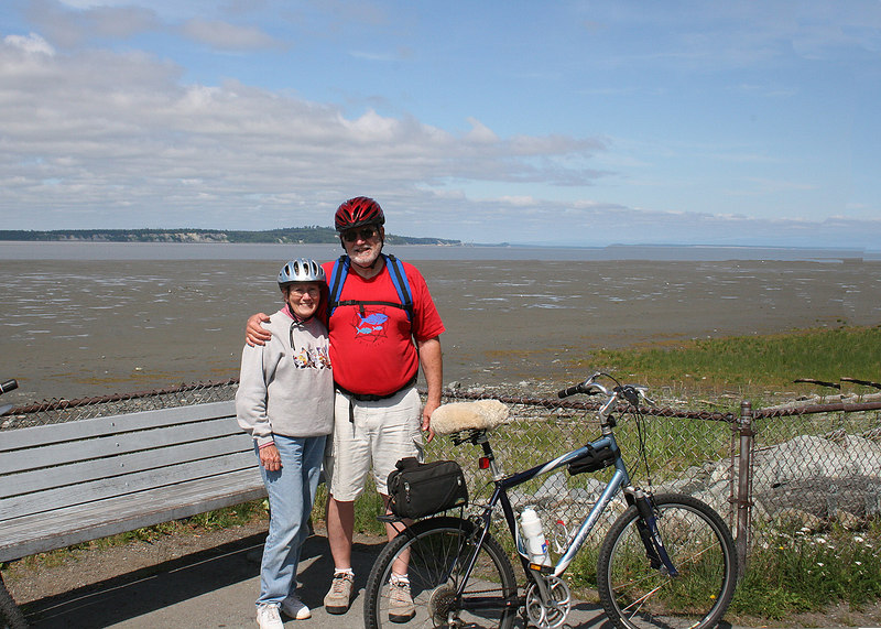 Mike and Susan with the mud flats along the Cook Inlet with McKenzie Point in the background.  Along one of many bike trails in Anchorage.