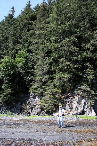 Mike at base of cliffs along beach at Tonsina Point, Seward, AK