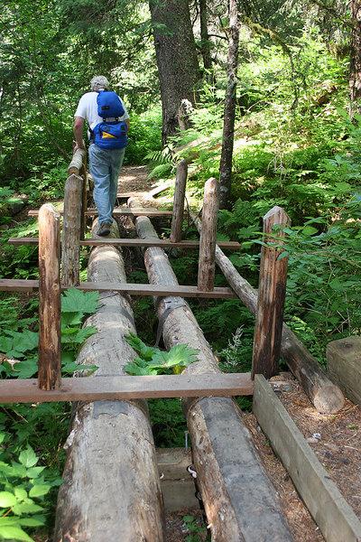 Mike crossing unfinished bridge on hike back