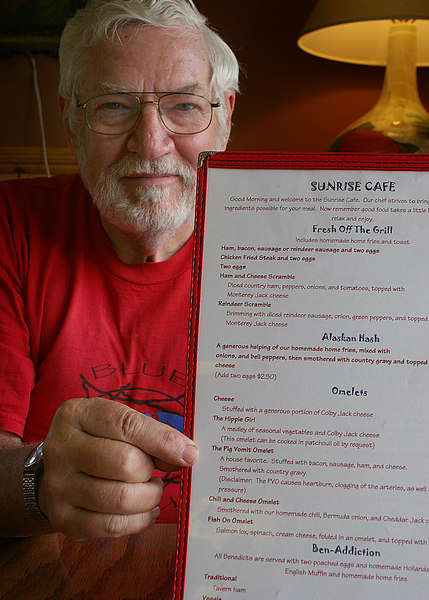 "Mike at Sunrise Restaurant pointing to the ""House Special"", the PVO.  I will let you read what PVO stands for!"