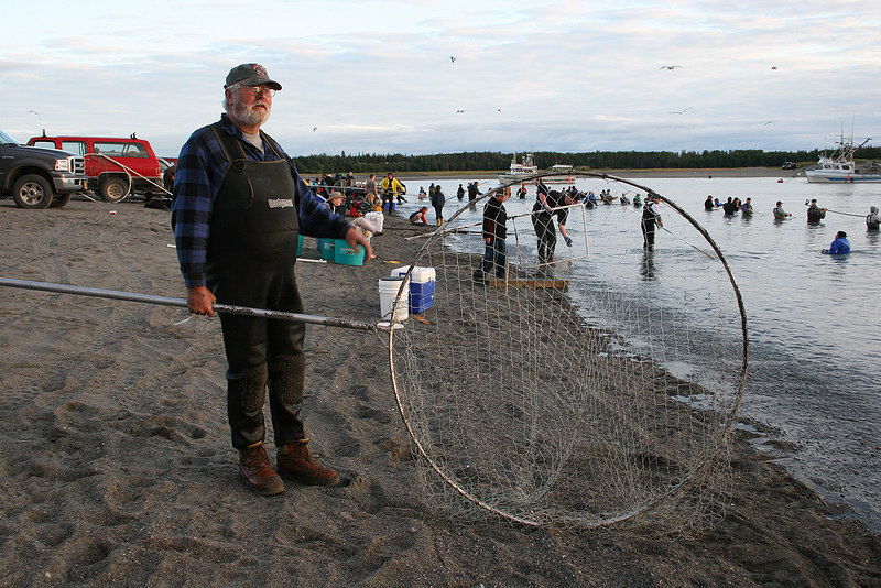 Dip netter at the mouth of the Kasilof River.  Subsistence fishing for locals only.