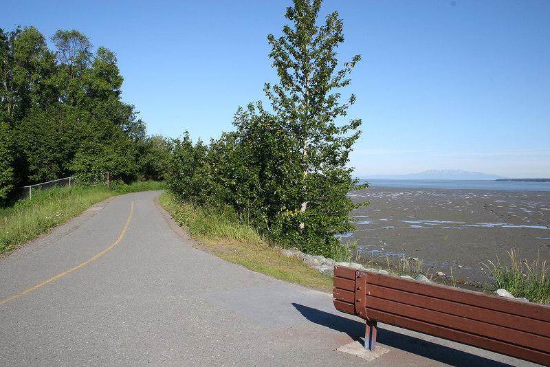 The trail follows the coast of Turnagain Arm with benches for resting along the way