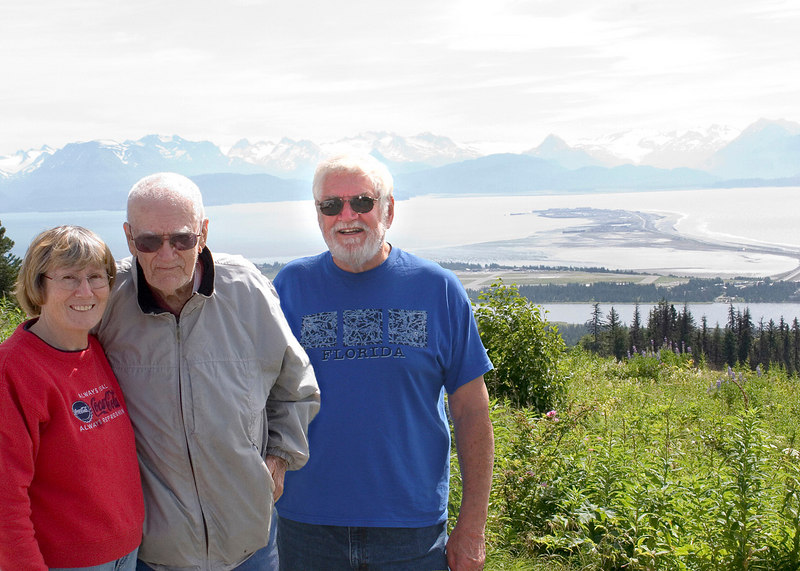 Susan, Claude (Mike's step-dad), and Mike with Homer Spit in the background from Baycrest Wayside as you are coming into Homer, AK