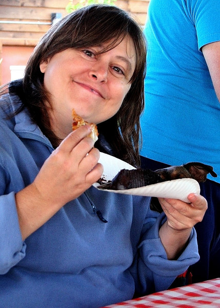Cheryl enjoying clams with her chocolate cake
