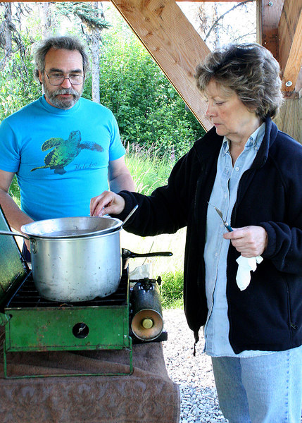 John and Diana, owners of the Kasilof RV Park, cooking clam fritters
