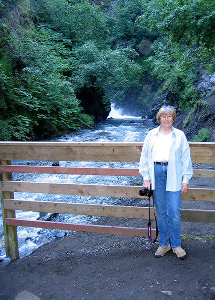 Susan at Eklutna River with a peek of the bottom of Thunderbird Falls in the background