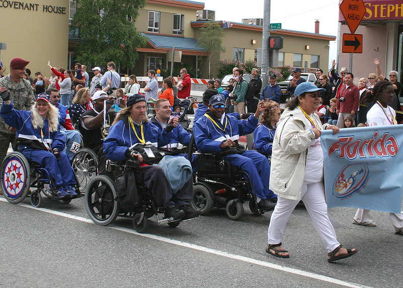"The parade started off with over 500 veterans who came to compete in the 27th National Veteran Wheelchair Games.  They ""marched"" in the parade alphabetically by state."