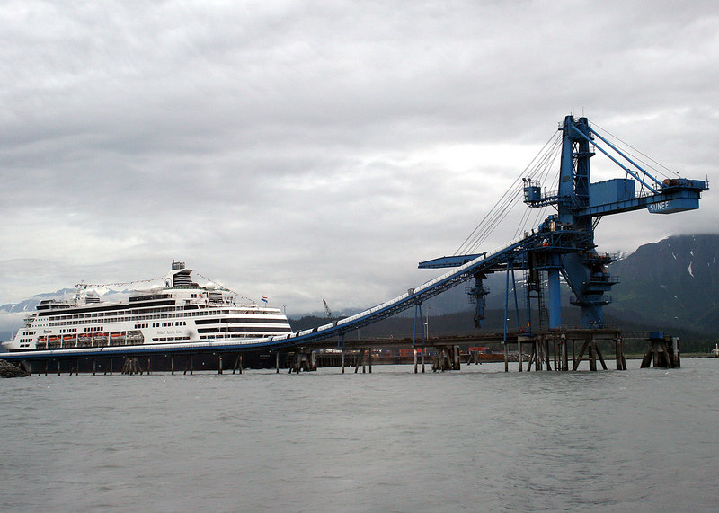 Cruise ship in back ground and equipment which loads coal