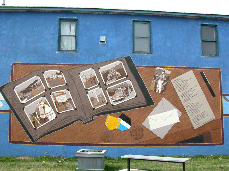 """5/11/06 - There are many murals on the Dawson Creek buildings. This one depicts the """"Alaska Highway"""""""