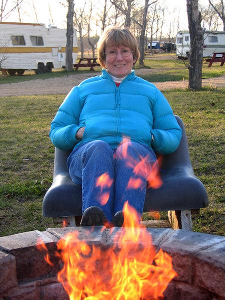 5/10/06 - Susan enjoying fire in the cool evening