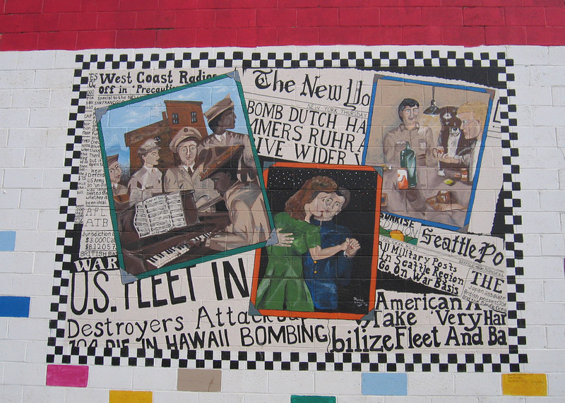 """5/11/06 - There are many murals on the Dawson Creek buildings. This one depicts the """"1941 Press Release"""""""