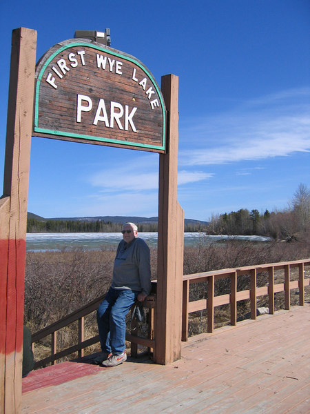 Mike at entrance to north end of Wye Park in Watson Lake, YT