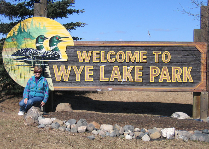 Susan at entrance to north end of Wye Park in Watson Lake, YT