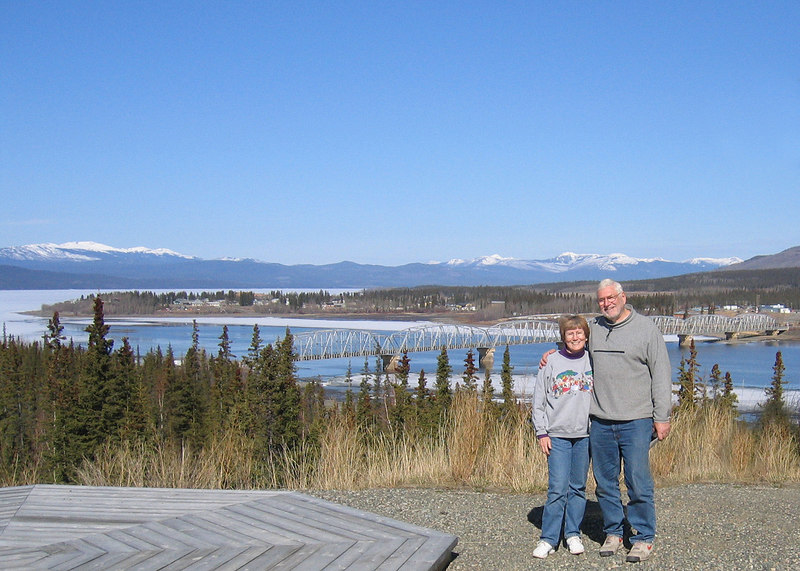 Mike and Susan with the Nisutlin Bridge at Teslin in the background