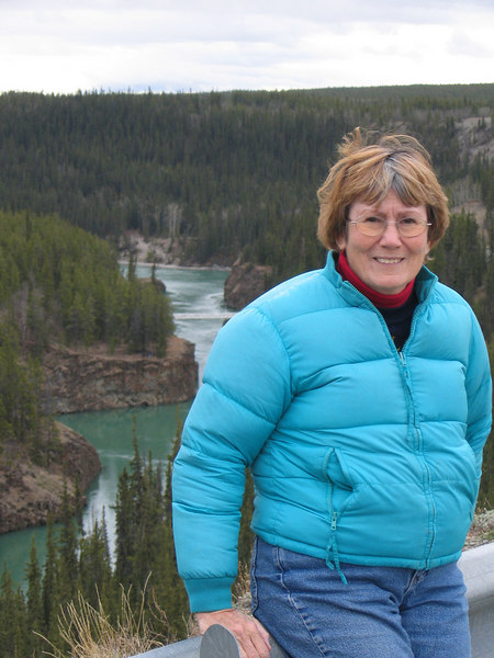5/17/06 - Susan with Miles Canyon and the Yukon River in background
