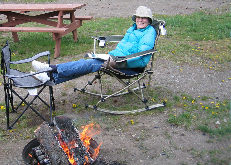 Susan relaxing by the fire.  If you look hard enough you can see the snow falling!