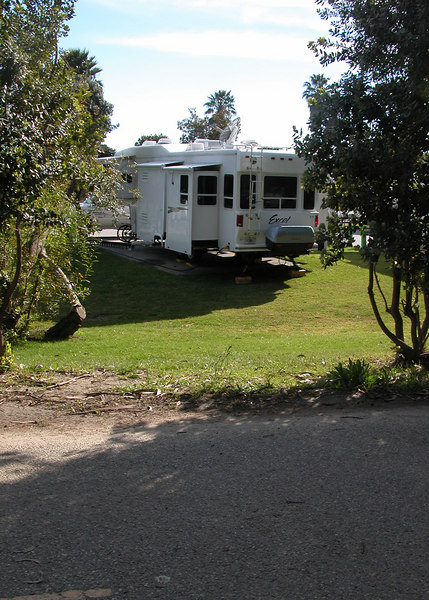 A picture of our 5th wheel from the bike/walking path