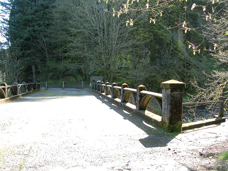 Old bridge at Oneonta Gorge.  At the end of the bridge used to be the opening of the Oneonta Tunnel.  The tunnel was filled with debris during the late 1940s when falling rock posed safety problems and the road was rerouted.