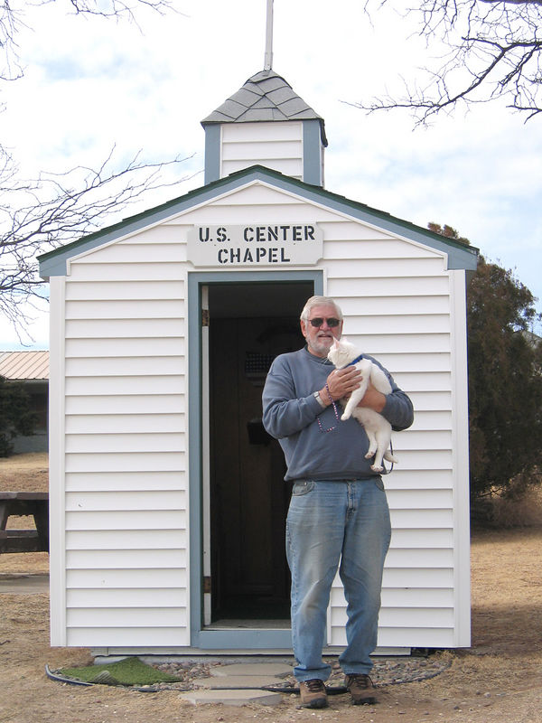 Mike and Moloko at chapel in park at the center of the contiguous 48 in Lebanon, KS.